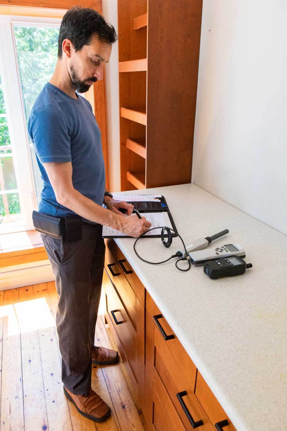 home inspector testing indoor air quality